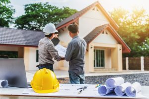 Two business man professional engineer worker at the house building.
