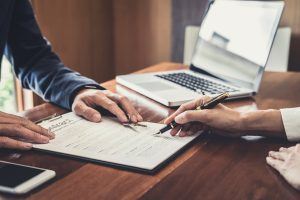Sales manager filing keys to customer after signing rental lease contract of sale purchase agreement, concerning mortgage loan offer for and house insurance