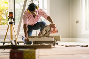 smart indian contractor hand use sawing machine wood work house renovation background home improvement ideas concept