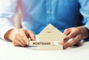Mortgage wooden jenga puzzle