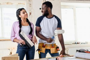 attractive young couple making renovation of apartments