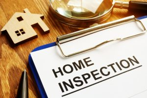 Home inspection form with clipboard and pen.